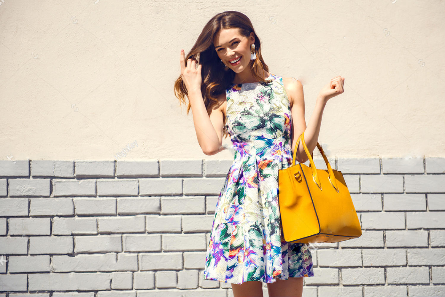 stock-photo-beautiful-brunette-young-woman-wearing-nice-dress-yellow-handbag-walking-on-the-street-fashion-618850901